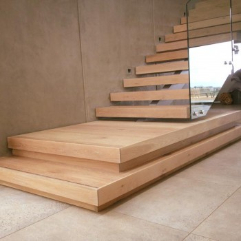 Centre spine Oak staircase with Panga Panga inlays