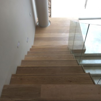 Floating Oak staircase with Panga Panga inlays